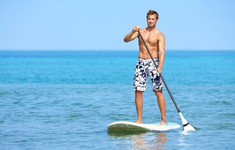 Stand up paddle board man